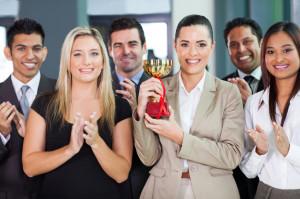 Happy business team winning
